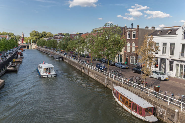 Netherlands Architecture Building Building Exterior Built Structure Canal Canal Houses City Cloud - Sky Craft Day Holland Mode Of Transportation Nature Nautical Vessel No People Outdoors Passenger Craft River Sky Transportation Tree Utrecht Vaartse Rijn Water Waterfront