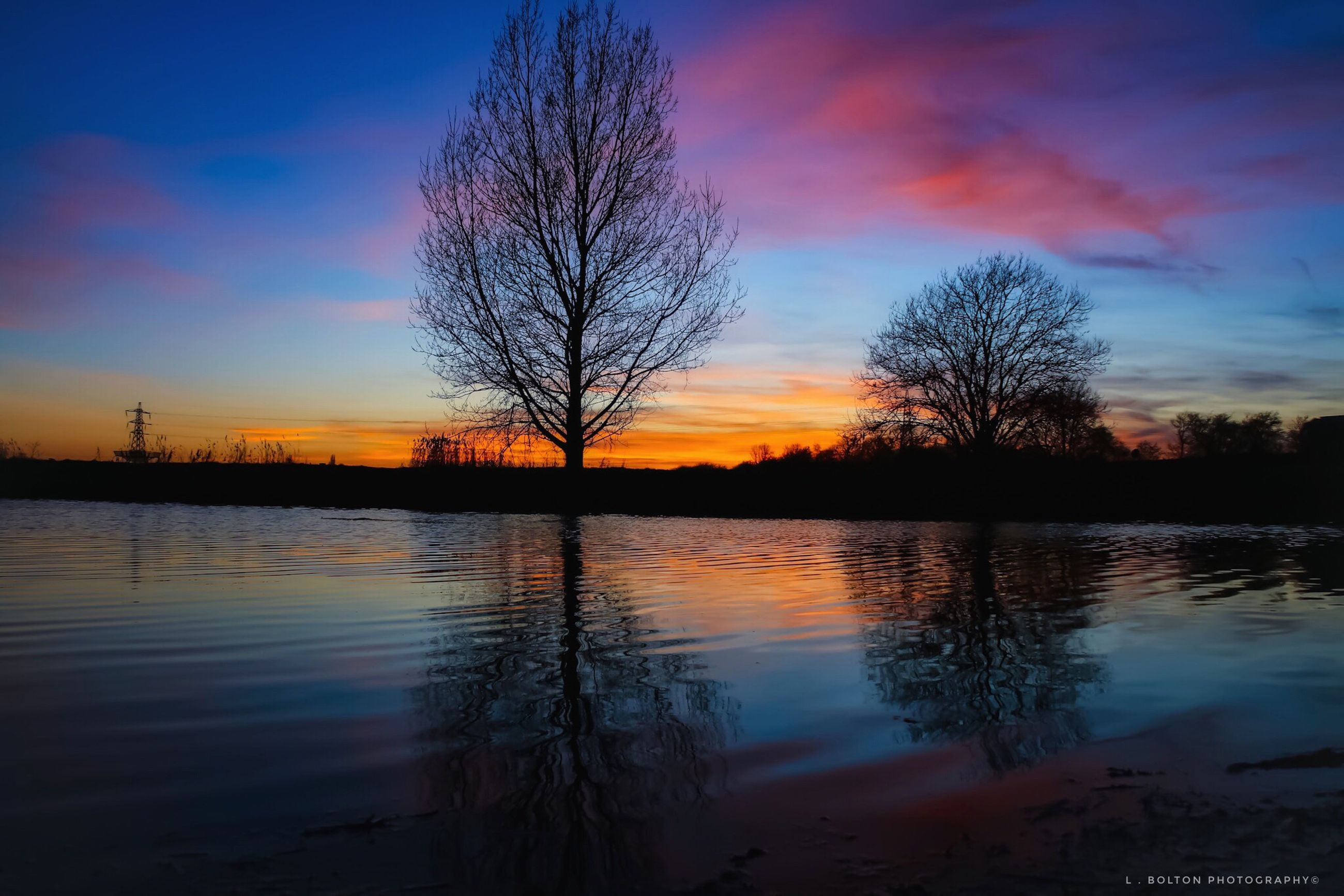 sky, sunset, water, reflection, tree, scenics - nature, beauty in nature, tranquil scene, tranquility, silhouette, orange color, lake, plant, cloud - sky, bare tree, nature, no people, non-urban scene, idyllic, outdoors, romantic sky