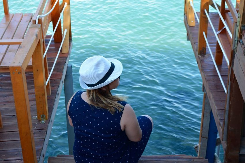 Meditation Relaxing Adult Casual Clothing Clothing Day Hair Hairstyle Hat Leisure Activity Lifestyles Looking At View Nautical Vessel One Person Outdoors Real People Rear View Sea Sun Hat Transportation Turquoise Colored Waist Up Water Women Young Women The Traveler - 2018 EyeEm Awards