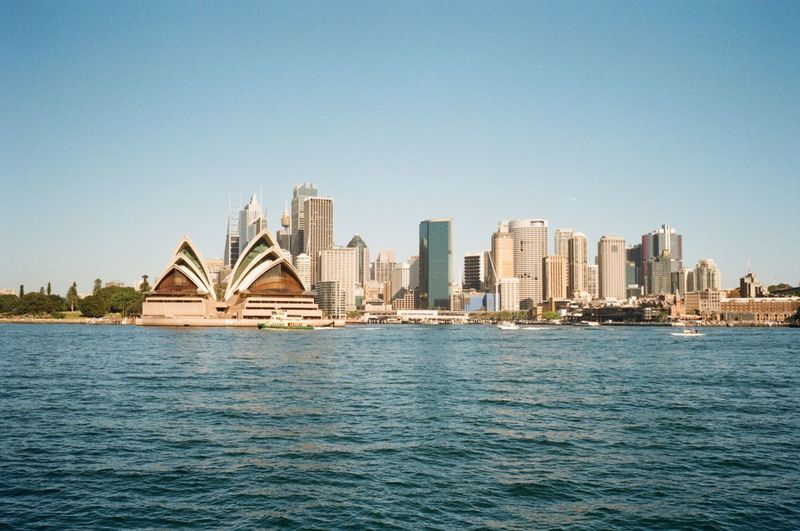 Sydney Opera House By River In City