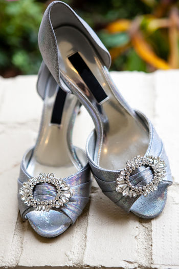 Close up shot of women's silver wedding shoes with jewels on the front. Jewels Wedding Wedding Photography Close Up Close-up Day Fashion Focus On Foreground No People Outdoors Pair Shoe Silver  Silver Shoes Still Life Women's Shoes