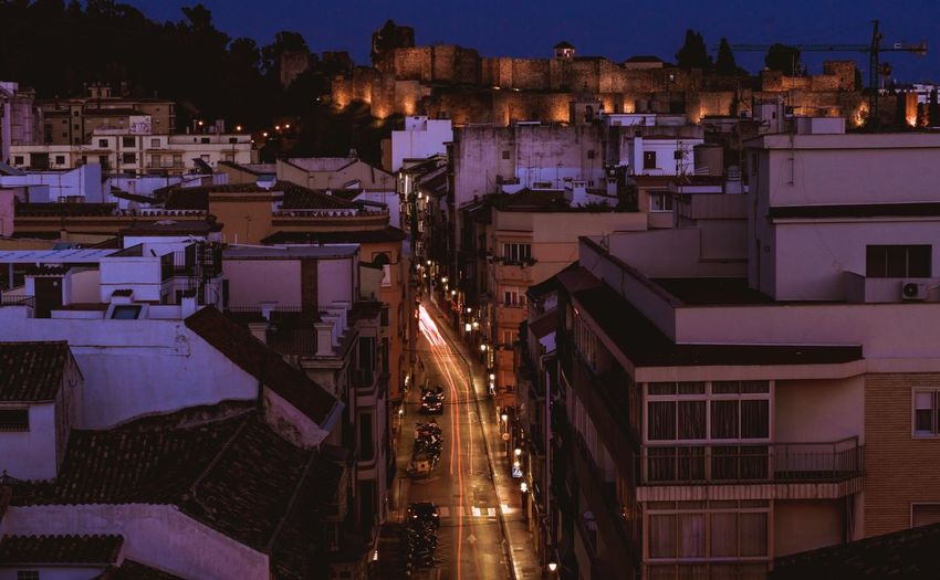 Málaga Building Exterior Night Illuminated Built Structure Architecture City High Angle View Residential District No People Building Nature Light - Natural Phenomenon Outdoors Cityscape Nightlife Street Plant Purple Tree Lighting Equipment