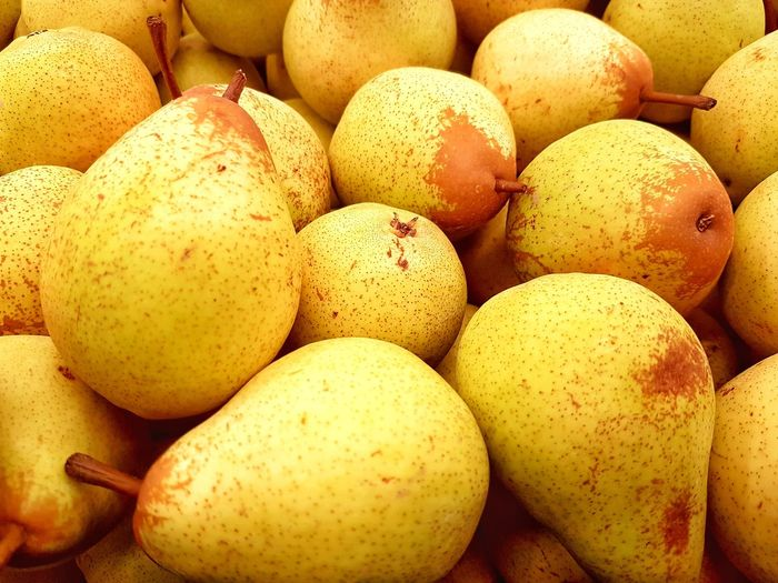 Full Frame Shot Of Pears For Sale At Market Stall