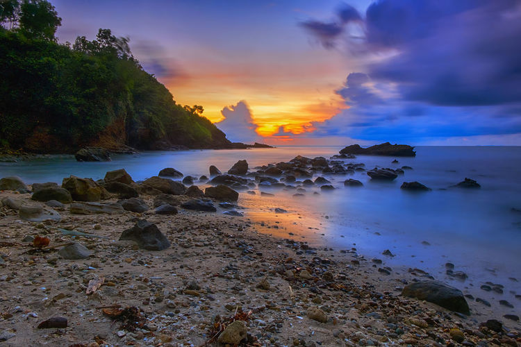 sunset on the beach INDONESIA Beach Beauty In Nature Central Java Cloud - Sky Horizon Over Water Idyllic Indonesia_photography Land Mengantibeach Nature No People Non-urban Scene Orange Color Rock Rock - Object Rocky Coastline Scenics - Nature Sea Sky Solid Sunset Tranquil Scene Tranquility Water