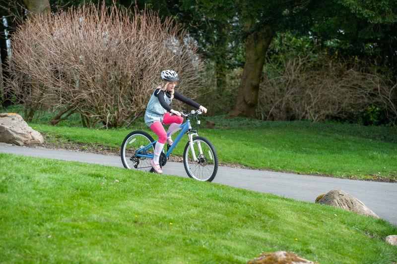Man riding bicycle on grassland
