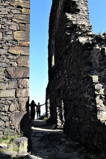 Czech Republic Architecture Basalt Building Exterior Built Structure Day History Leisure Activity Medieval Old Ruin Outdoors Real People Sky Solid Standing Stone Wall Sunlight The Past Tourism Travel Two People