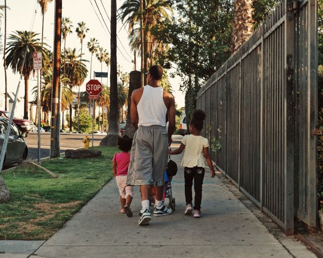 Fatherhood  Childhood Palm Tree Togetherness Tree Casual Clothing Day Adult Love Family Urban Life Fatherhood Moments Father And Daughter Parenthood Parenting Walking City City Life West Coast Living Rear View Leisure Activity Outdoors Civilization Happiness Streetphotography The Street Photographer - 2017 EyeEm Awards
