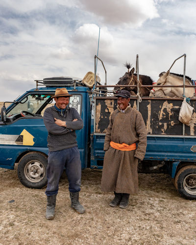 Mongolia Mode Of Transportation Transportation Cloud - Sky Two People Land Vehicle Sky Real People Full Length Motor Vehicle Adult Men Occupation Nature Mid Adult Day People Males  Mid Adult Men Standing Car Outdoors Farmer