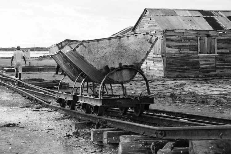 Dominican Republic Abandoned Architecture Black And White Blanco Y Negro Damaged Day Mode Of Transport No People Outdoors Playa Salinas Produccion Sal Rail Transportation Railroad Track Sky Transportation