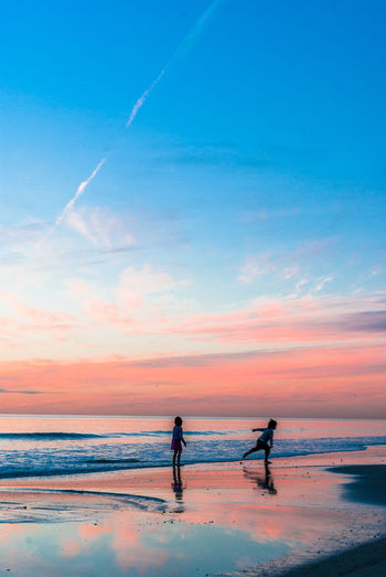 Sea Two People Sunset Horizon Over Water Outdoors Beauty In Nature Kids Nature Beach Sky Water
