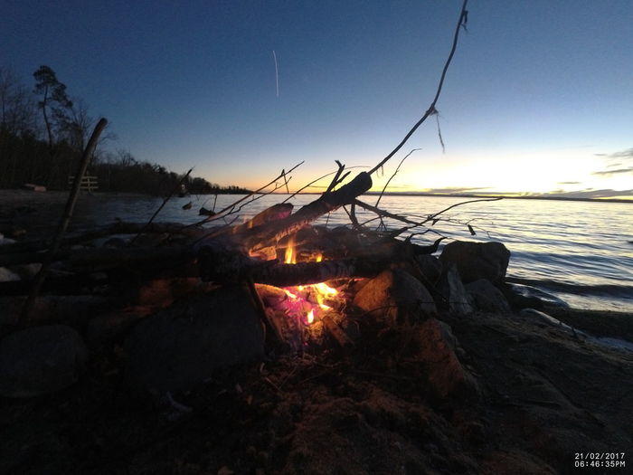 Beach Beauty In Nature Campfire Campinglife Day Fire Great Lakes Horizon Over Water Lakeshore Nature Night Night Lights No People Outdoors Scenics Sea Sky Sunset Tranquility Water Wintertime Camp