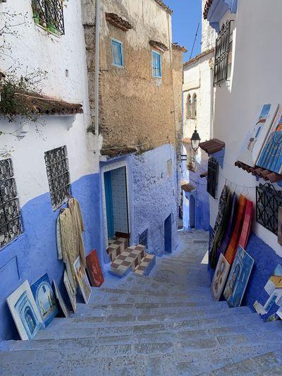 Paintings in alley amidst buildings in city