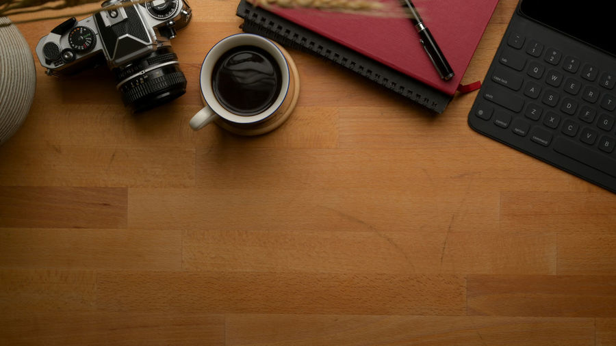 Directly above shot of coffee with camera on table