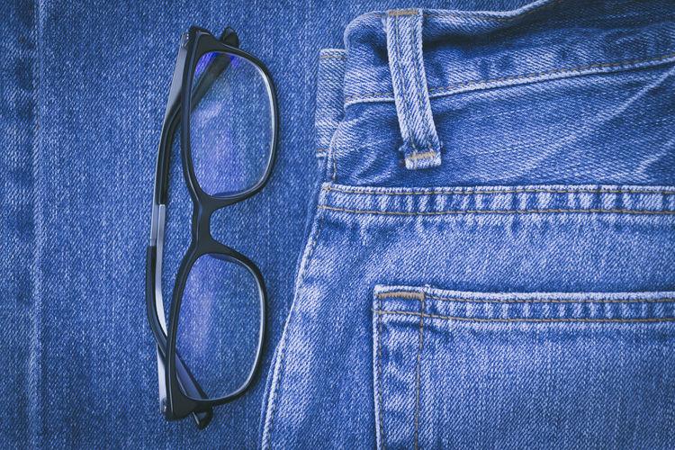 vintage style eyeglasses on blue jeans Glasses Backgrounds Blue Casual Clothing Close-up Clothing Denim Eyeglasses  Fashion Full Frame Garment Indoors  Jeans No People Personal Accessory Pocket  Single Object Still Life Studio Shot Textile Textured  Vintage Zipper