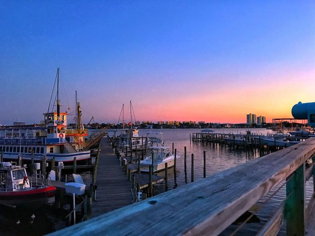 Nautical Vessel Sunset Water Harbor Moored Clear Sky Outdoors Architecture No People Sea Travel Destinations Built Structure Tranquility Sky Building Exterior Scenics Nature City Cityscape Sunset
