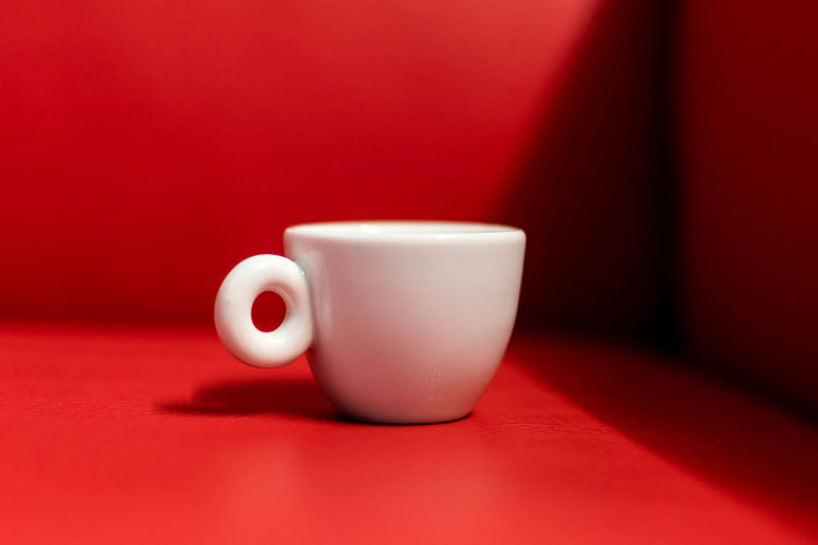 Close-up Coffee Coffee - Drink Coffee Cup Copy Space Crockery Cup Drink Food And Drink Hoffi99 Hot Drink Indoors  Minimalism Mug No People Non-alcoholic Beverage Red Red Background Red Leather Refreshment Still Life Table Tea Cup White Color