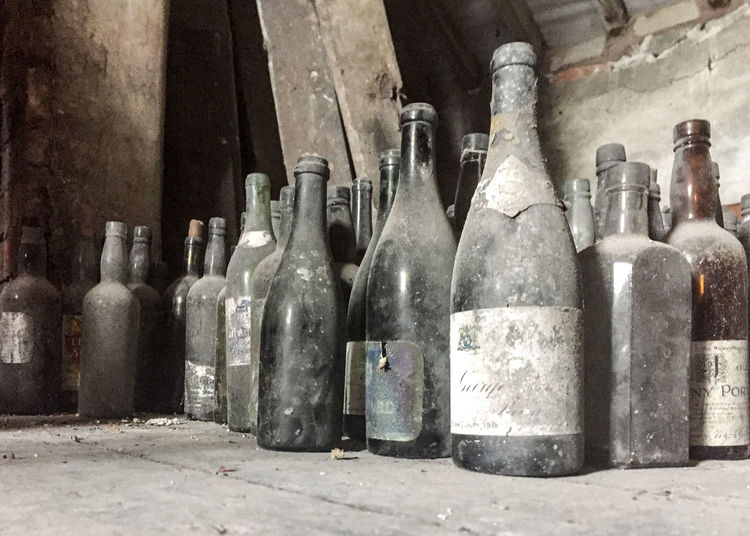 Attic Finds Forgotten Abandoned Architecture Attic Bottle Choice Collection Container Day Dirty Drink Dusty Forgotten Things Glass - Material In A Row Indoors  Large Group Of Objects No People Obsolete Old Refreshment Still Life The Past Variation