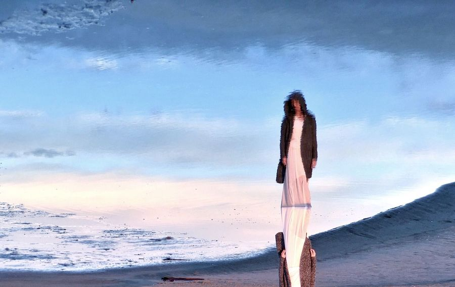 I love the way life looks so surreal when reflected on water. Reflection Beach Surreal Water Ocean Painting Fine Art Woman Standing Alone Sunrise Light And Shadow Clouds Sky Blue Sky Things I Like Fine Art Photography