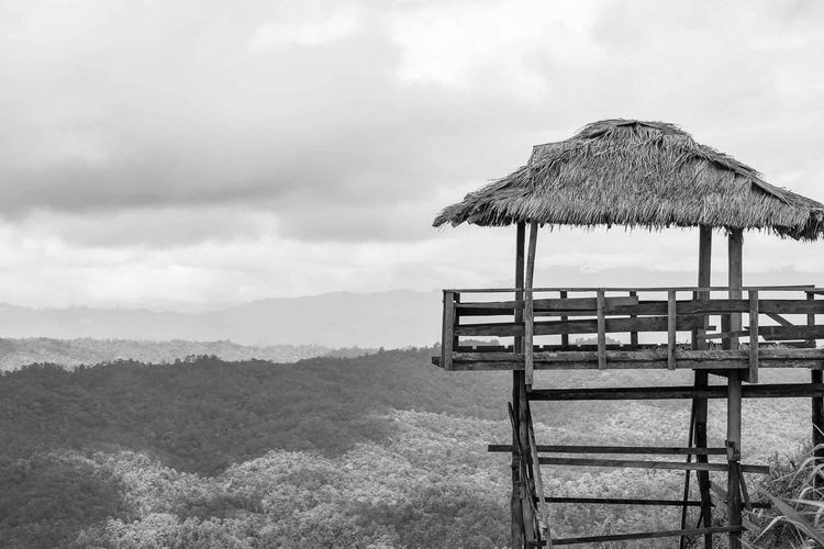 Old Pavilion Along Thatched Roof Roof Sky Beauty In Nature Scenics - Nature Mountain Cloud - Sky Day Nature Land Tranquility Tranquil Scene No People Protection Outdoors Absence Idyllic Landscape Seat