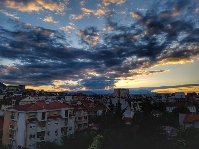 Cloud - Sky Sunset City Sky House Cityscape Outdoors Multi Colored No People Residential Building Built Structure Town Architecture Building Exterior Nature Urban Skyline Viewfrommyterrace Hood