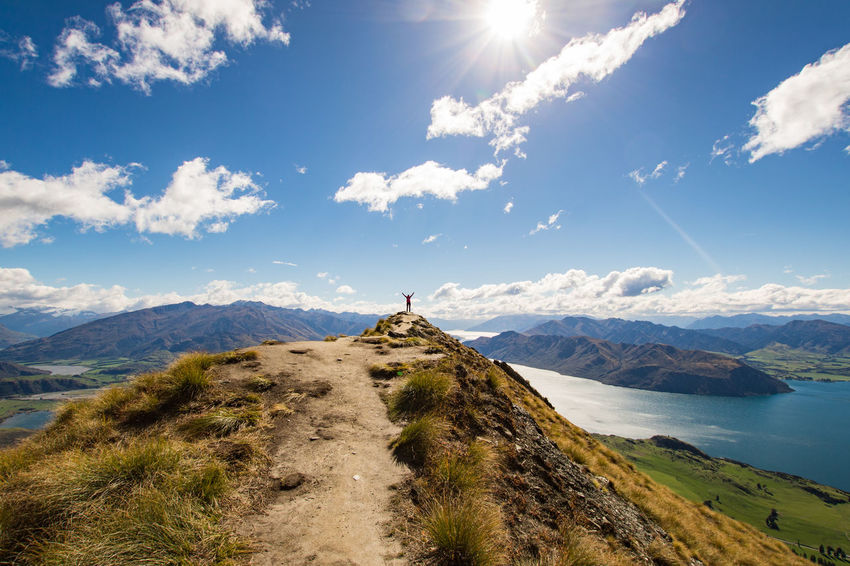young woman standing on the roys peak lookout and watching over the moutains and lake wanaka on a beautiful atumn day Wanaka Arms Raised Beauty In Nature Cloud - Sky Day Idyllic Land Landscape Leisure Activity Lifestyles Mountain Mountain Range Nature New Zealand Non-urban Scene Outdoors Real People Roys Peak Scenics - Nature Sky Standing Sunlight Tranquil Scene Tranquility Water The Great Outdoors - 2018 EyeEm Awards