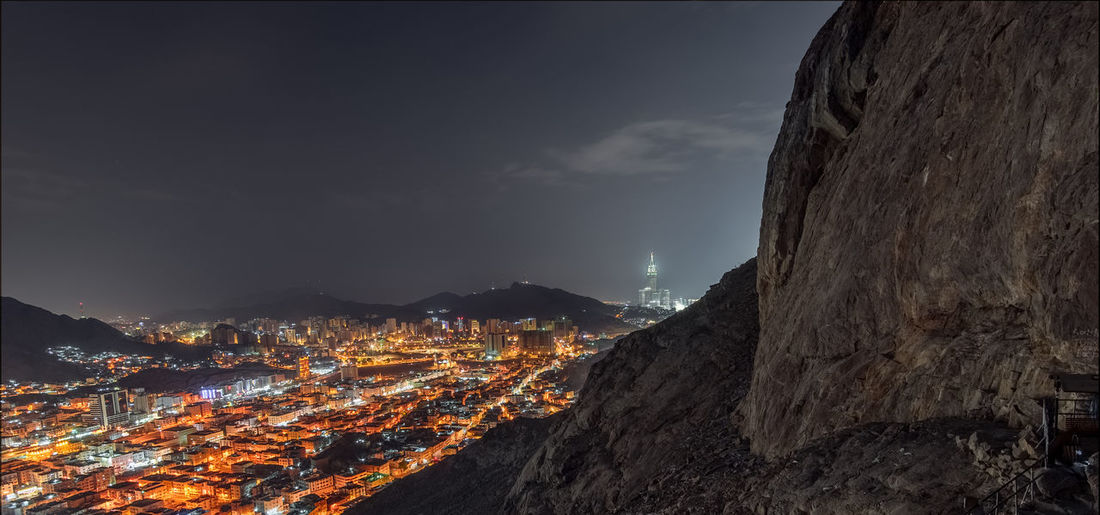 Hiking Jabal al Nur at night overlooking holy Mecca city Hiking Hira Cave Jabal Al Nour Night View Alharam Mecca Neon City Illuminated Mountain Star Trail Cityscape Nightlife Astronomy Sky Mountain Range