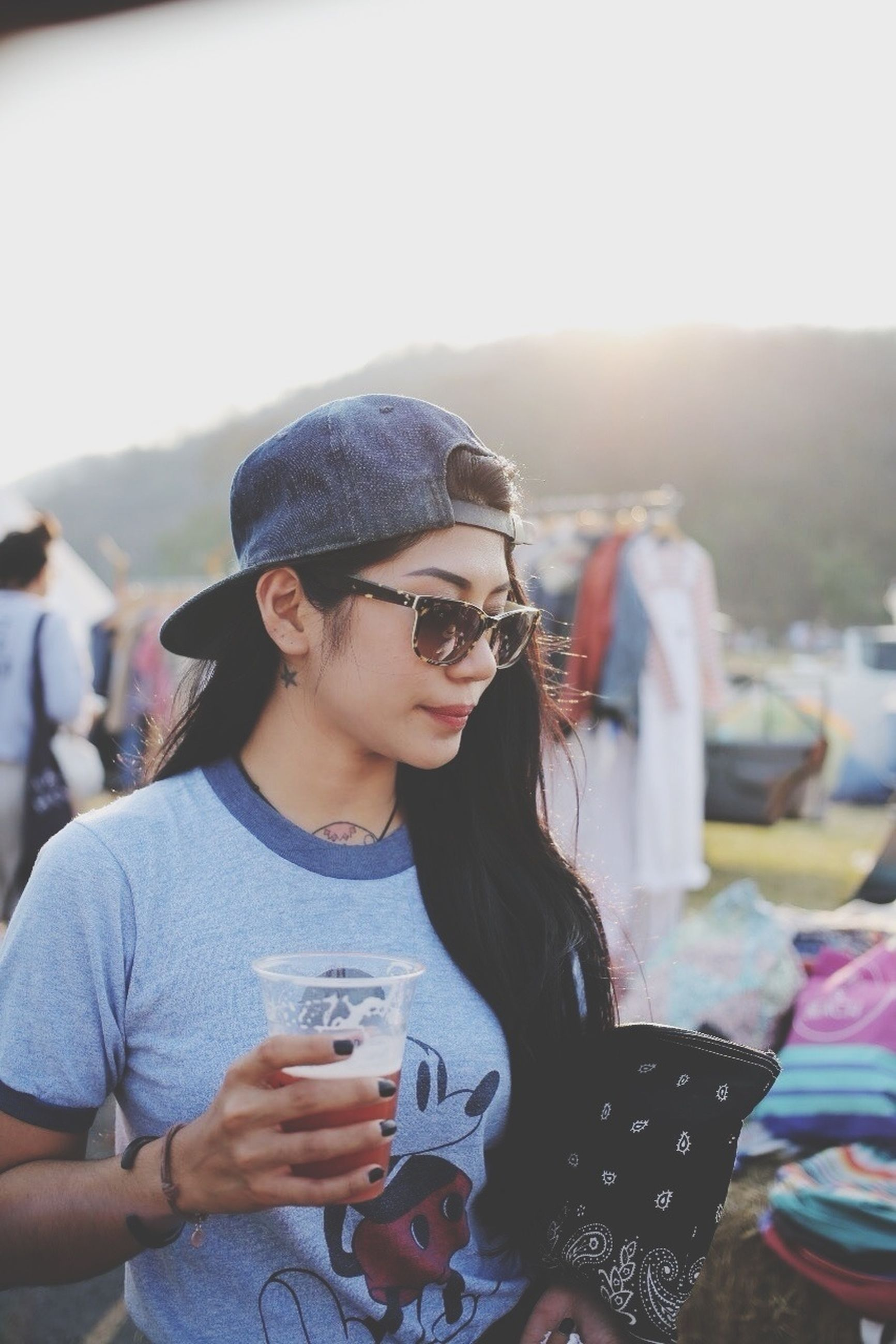 lifestyles, young adult, leisure activity, person, sunglasses, looking at camera, portrait, casual clothing, young men, focus on foreground, front view, headshot, smiling, holding, waist up, happiness, head and shoulders