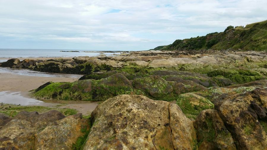 Scotland Hills Beach Rocky Rocks Sand Stones Seaside Ocean Water Moss Clouds And Sky Colour Image Day Horizontal Nature No People Non-urban Scene Outdoors The Great Outdoors With Adobe Sea Sky Tranquil Scene Tranquility The KIOMI Collection