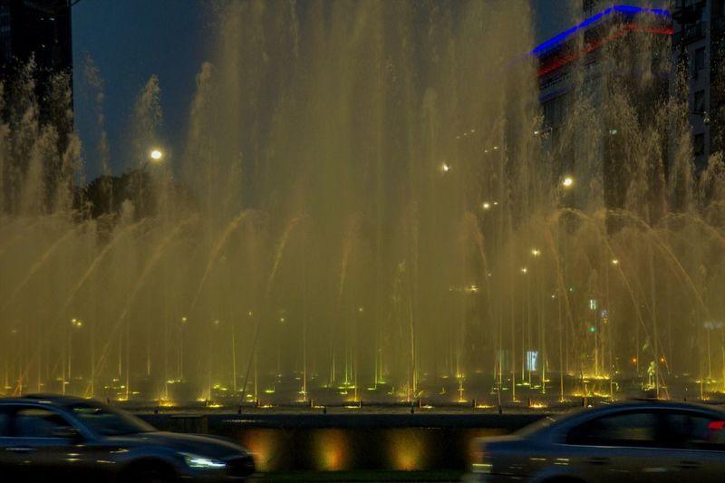 Impressive illuminated fountain on Slavija Square / Belgrade, Serbia Illuminated Mode Of Transportation Water Street City Architecture Fountain Street Lights Night
