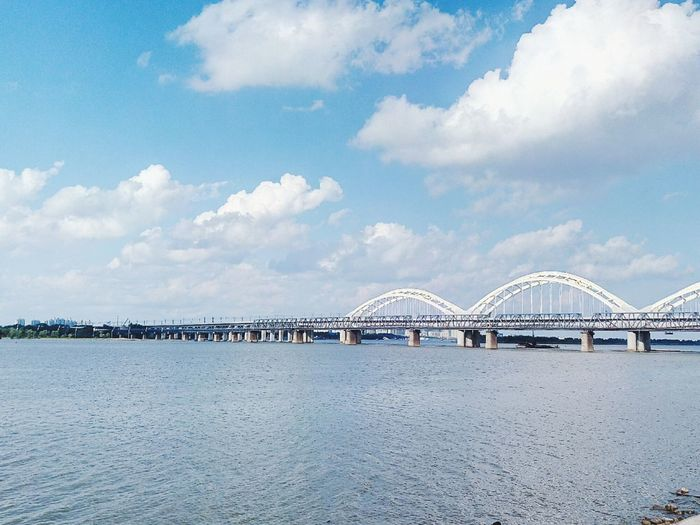 Songhua river in Harbin China Bridge - Man Made Structure Sky Architecture Cloud - Sky Built Structure Business Finance And Industry No People Sea Day Outdoors Arts Culture And Entertainment Travel Destinations City Harbor Cityscape
