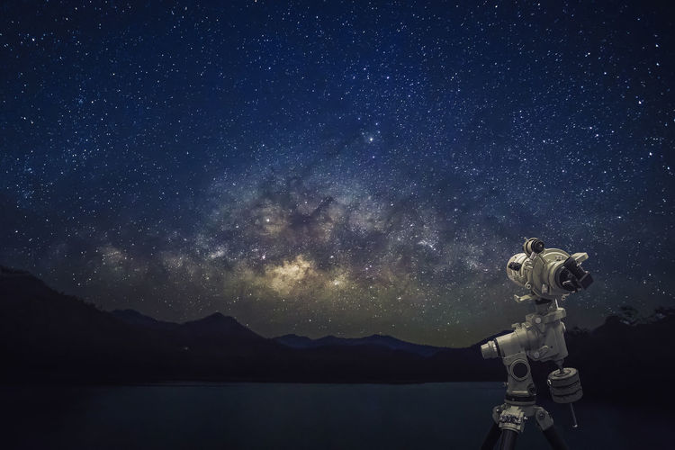 Telescope with starry night milky way Art And Craft Astronomy Beauty In Nature Galaxy Human Representation Milky Way Mountain Nature Night No People Outdoors Representation Scenics - Nature Science Sky Space Space Exploration Star - Space Technology Tranquil Scene Tranquility
