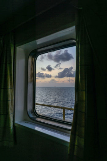 Scenic view of sea seen through train window