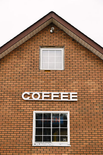 Brick Wall Coffee Coffee Shop Sign Signs Typography Building Exterior Coffee - Drink Coffee Sign Drink Font Information Information Sign Signs, Signs, & More Signs Signs_collection Window
