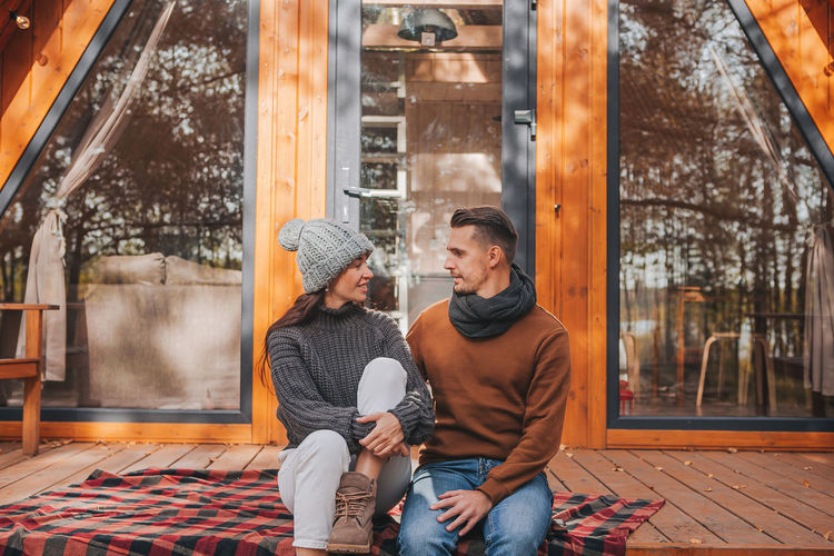 Couple sitting in park during winter