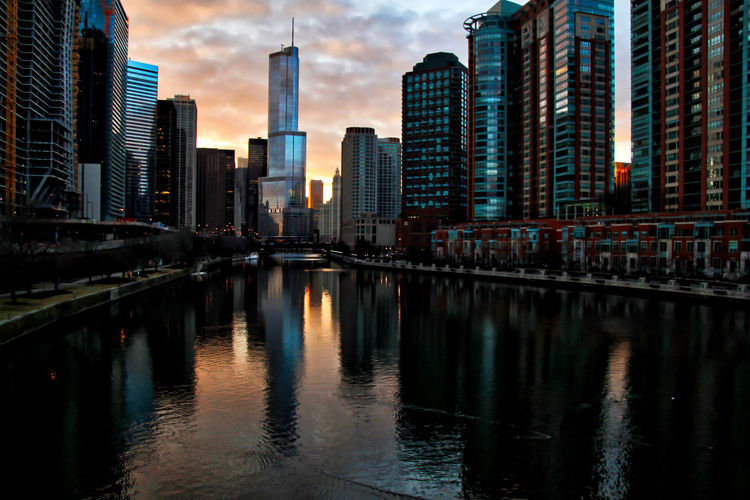 Chicago during a colorful winter sunset, which is reflected in the Chicago River. Waysofseeing Chicago Chicago River Chicago Loop Cityscape Downtown Chicago Exterior Reflection Riverside Skyline Trump Tower Wacker Drive Winter Bridge - Man Made Structure Buildings Colorful Evening Outdoors Riverwalk Sky Skyscraper Sunset Urban Urban Skyline Water Waterfront