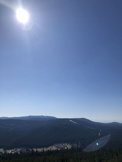Scenic view of mountains against clear blue sky