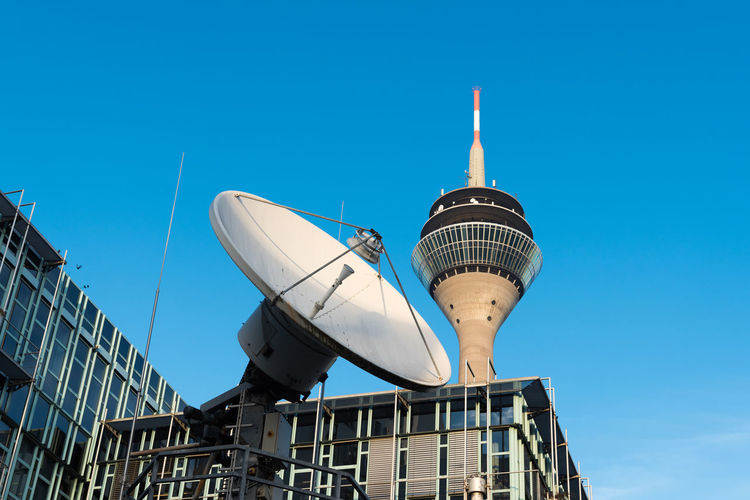 DUESSELDORF, GERMANY - JANUARY 20, 2017: The WDR as one of the important TV and radio broadcasting companies in Germany has its NRW headquarter and country studios in the New Media Harbor Antenna - Aerial Attraction Broadcasting Communication Düsseldorf Global Communications Harbor Lifestyle Medienhafen New Media Harbor NRW Outdor Relaxing Rhein Rhine River S Satellite Dish Scenic Technology Touist Attraction Tourism Tower Urban Water