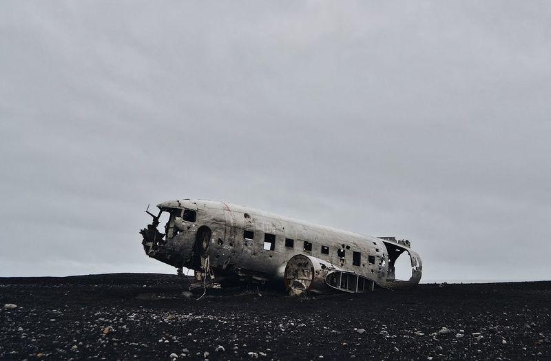 Airplane wreck at solheimasandur against sky