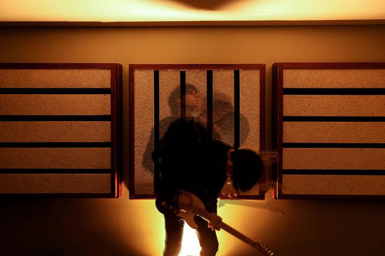 Rear view of girl standing in corridor