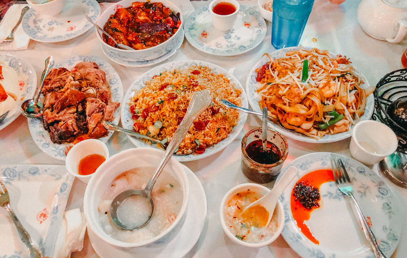 Chinese Food Bowl Chinese Chinese Food Choice Crockery Eating Utensil Food Food And Drink Freshness Glass Healthy Eating High Angle View Indoors  Kitchen Utensil Meal Meat No People Plate Ready-to-eat Spoon Still Life Table Variation Wellbeing