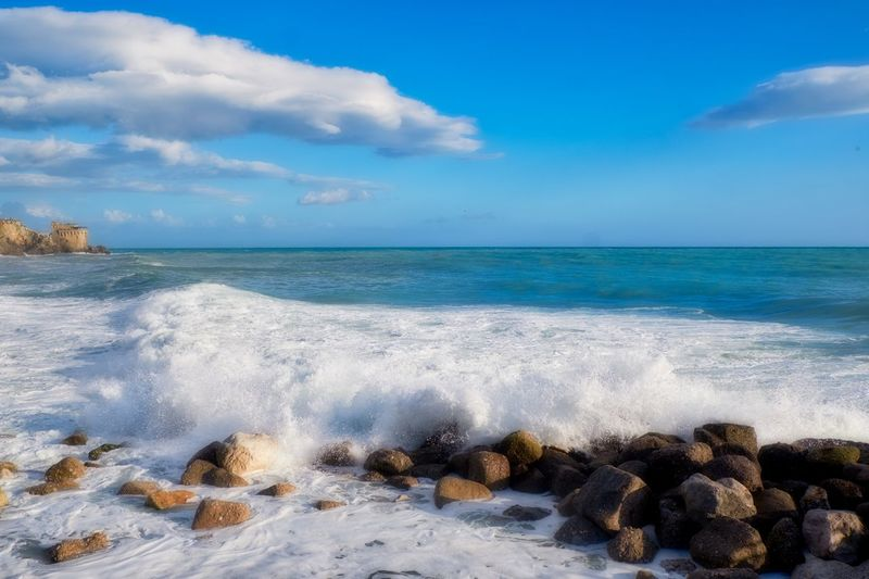Castle Beach Beauty In Nature Breaking Campania Cloud - Sky Horizon Horizon Over Water Idyllic Land Motion Nature No People Outdoors Power In Nature Rock Rock - Object Scenics - Nature Sea Sky Solid Sport Tranquil Scene Water Wave