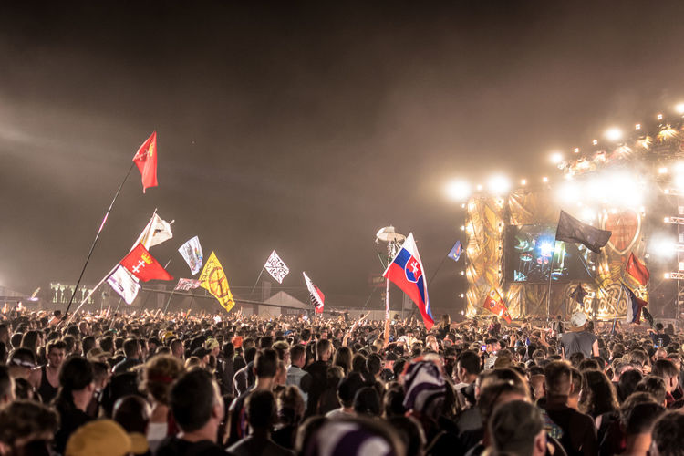 Crowd Group Of People Large Group Of People Flag Arts Culture And Entertainment Real People Music Event Fan - Enthusiast Audience Stage - Performance Space Spectator Enjoyment Performance Music Festival Festival Night Celebration Stage Positive Emotion Excitement Watching Outdoors Rock Music Stage Light