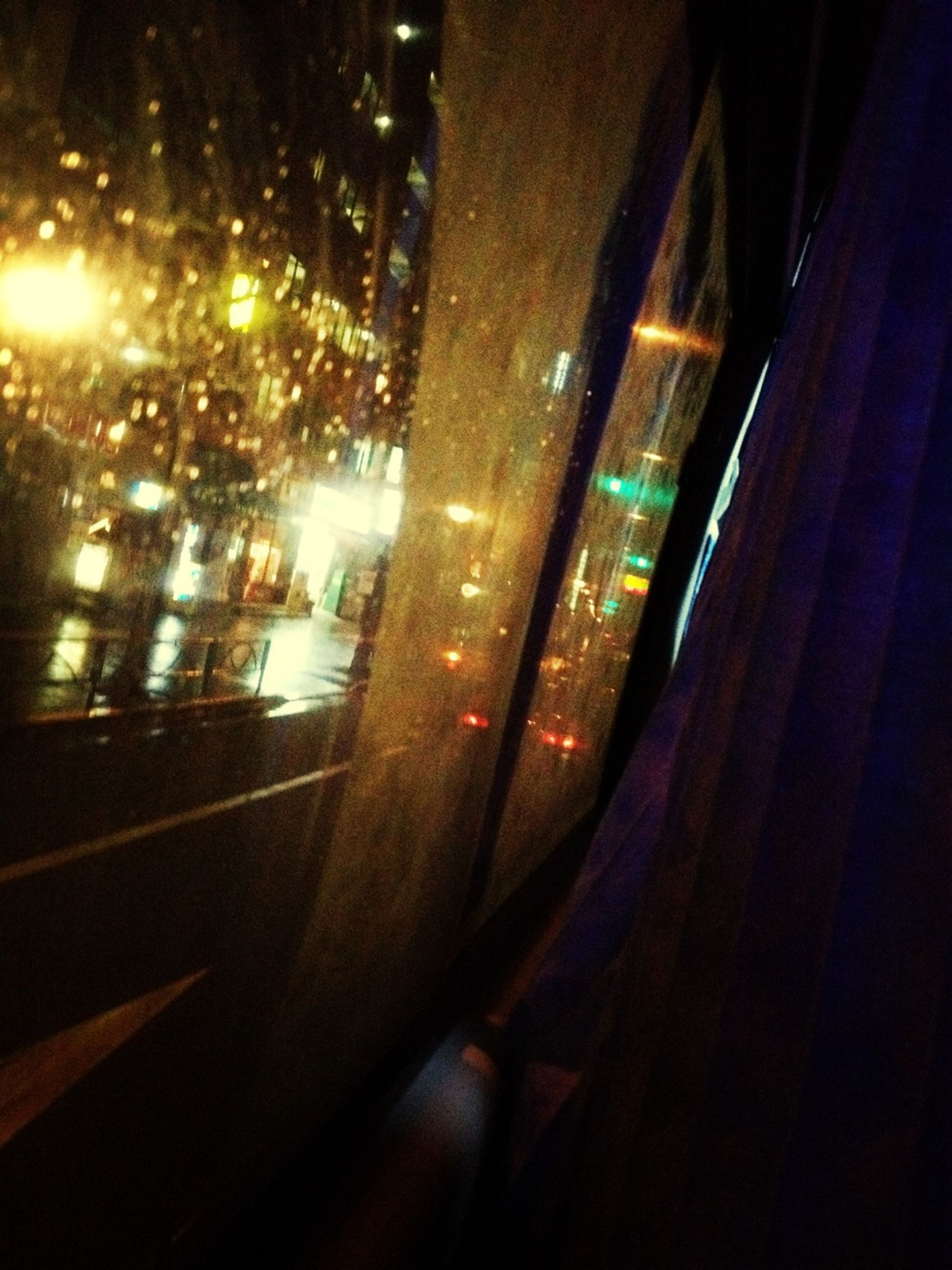 transportation, mode of transport, illuminated, land vehicle, car, night, glass - material, on the move, vehicle interior, transparent, travel, road, window, public transportation, windshield, motion, indoors, speed, blurred motion, car interior