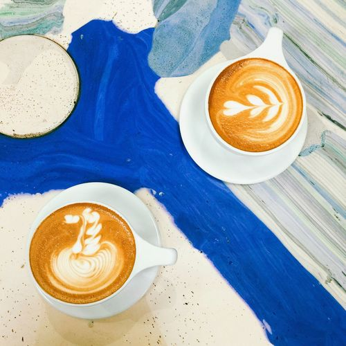 Refreshment Lifestyles Leisure Time Latte Art Latte Table Blue Painting No People Coffee - Drink Cafe Modern Workplace Culture