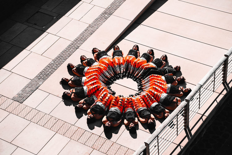 Real People Group Of People Architecture Large Group Of People Men Leisure Activity High Angle View Crowd Women Built Structure Lifestyles Day Geometric Shape Outdoors Shape Circle Adult Orange Color Building Exterior