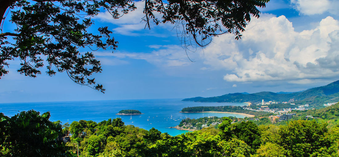 Beautiful landscape of turquoise ocean waves with boats, coastline and blue sky background from high aerial view point of Kata and Karon beaches in Phuket Thailand. Aerial View Of Beach Coastline Coastline Landscape Coastline Nature Water Karon Beach, Phuket Kata Beach Kata Beach,Phuket Thailand Kata Beach Phuket, Thai Seashore Aerial View Beauty In Nature Blue Branch Cloud - Sky Coastline Beauty Coastline Sky Day Growth Horizon Over Water Idyllic Karon Karon Beach Karon View Point Kata Landscape Nature No People Ocean Wave. Ocean Waves Ocean Waves Hits The Rock Outdoors Scenics Sea Seascape Seaside Sky Tranquil Scene Tranquility Tree Turquoise Turquoise Sea Water