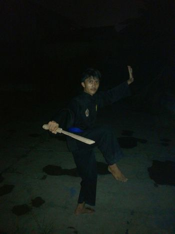 training Pencak Silat Fighter Silatindonesia Kpsnusantara EyeEm INDONESIA EyeEm Gallery One Person Full Length Adult Dark Studio Shot Indoors  Aggression  Young Adult Bizarre Men Human Body Part Black Background Digital Composite Sport Night