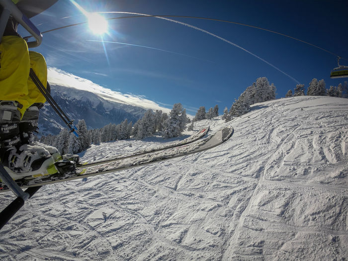 Winter Snow Mountain Cold Temperature Sky Scenics - Nature Sport Skiing Lens Flare Beauty In Nature Sunlight Winter Sport Sunbeam Nature Adventure Landscape Mountain Range Environment Leisure Activity Sun Snowcapped Mountain Outdoors