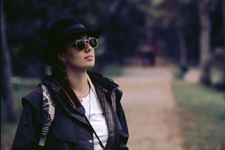 Portrait of senior woman wearing sunglasses standing outdoors