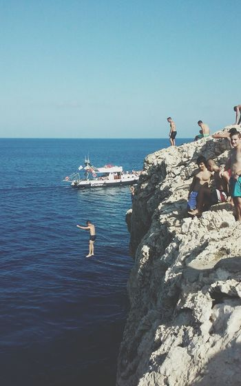 Boat Adventure Jumping Cliff Horizon Over Water Sky Cliff Jumping Sea People Island Cliff Diving Woman In Bikini Looking At The Sea Summer Fun Adventure Club